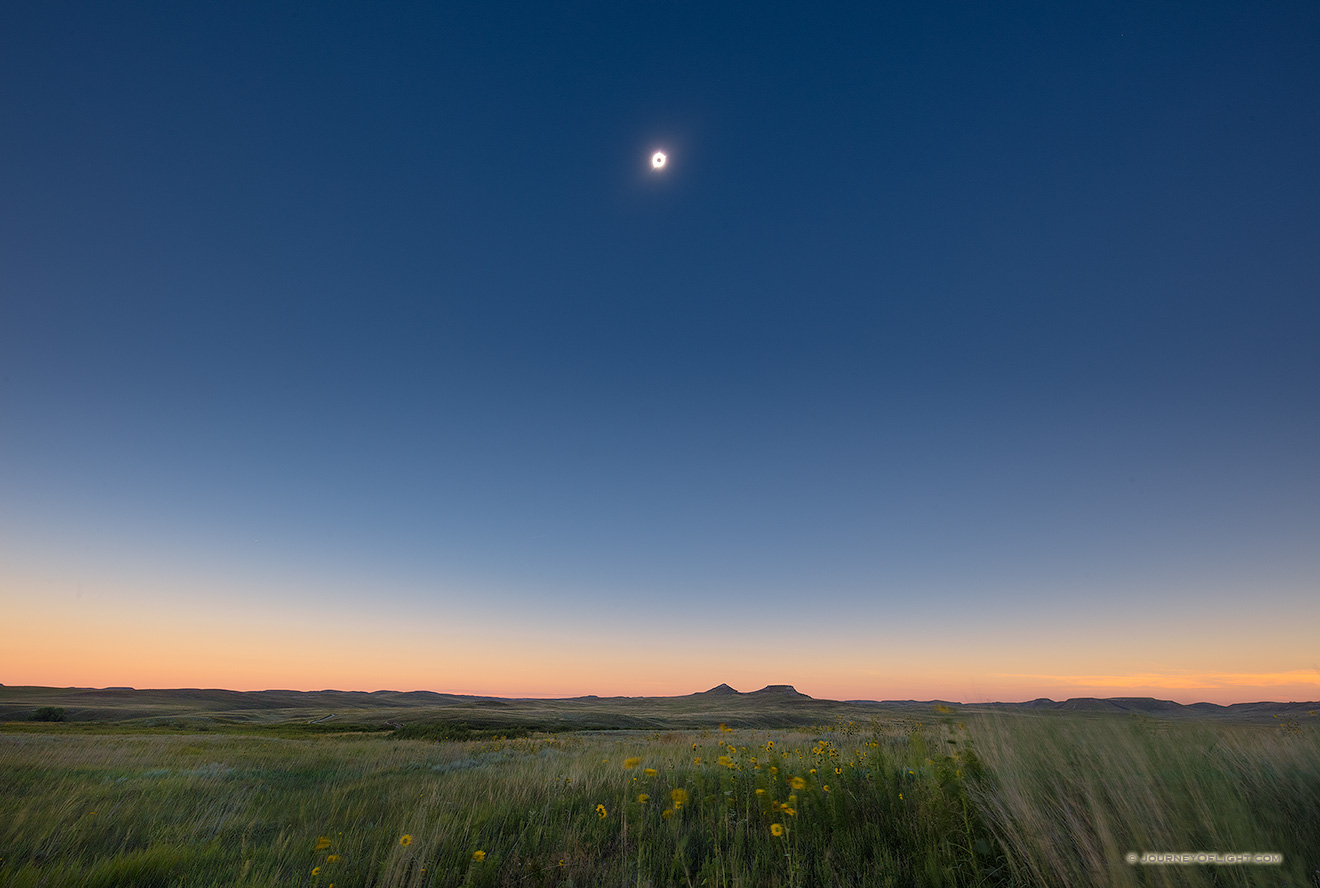 During Totality of the Total Solar Eclipse Agate Fossil Beds National Monument appears to plunge briefly into twilight while the sun